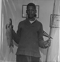 Lawrence holding Fish caught with flimsy pole
